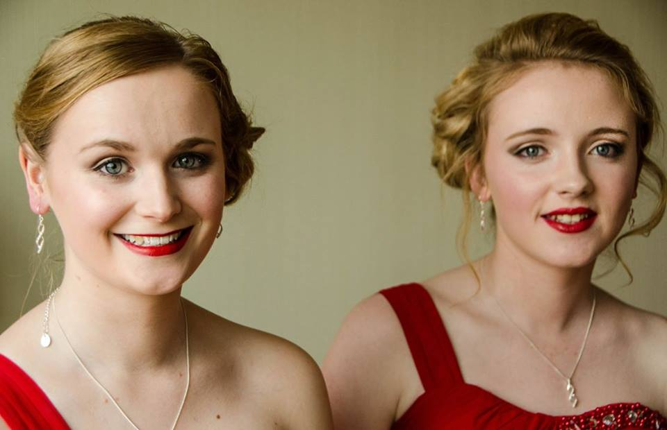 Photo of Bridesmaids with up styles