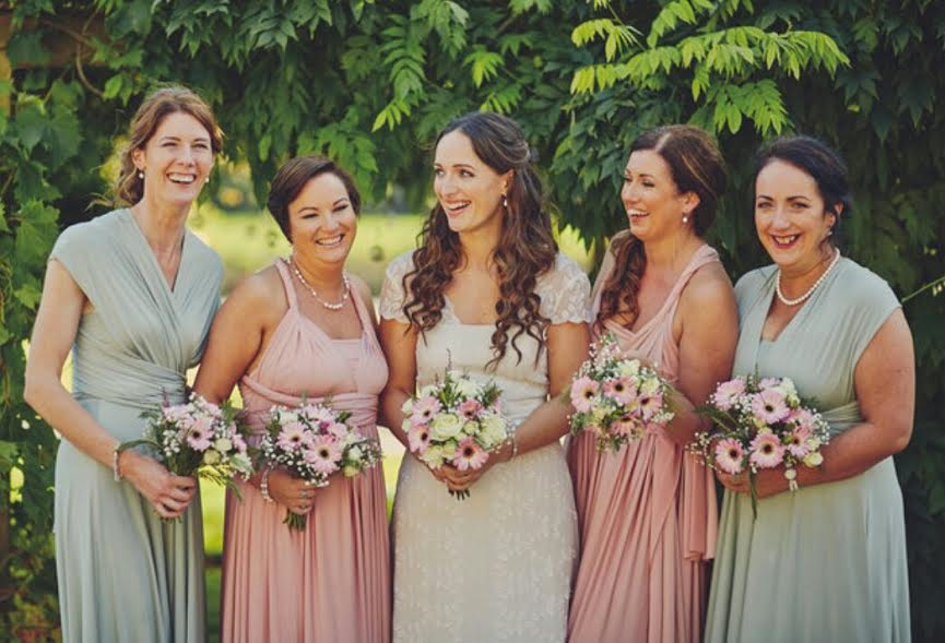 Group photo of bridesmaids with their hair and makeup done on a sunny wedding day