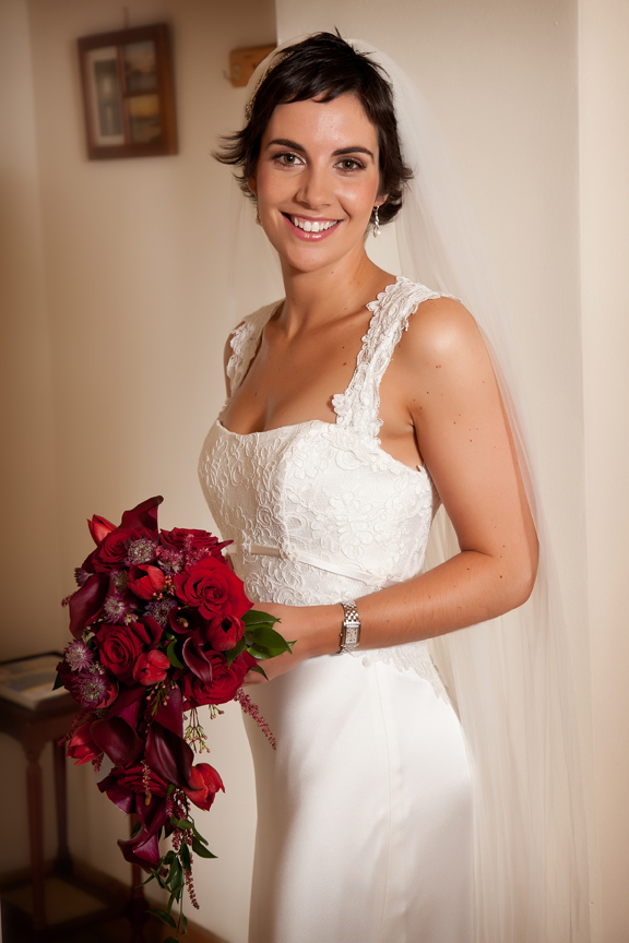 Photo of Bride in Galway in Makeup and dress holding flowers