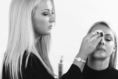 Image of Rachel applying bridal makeup to a bride on her wedding day